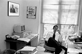 Obama in his University of Chicago law school office with a photo of Harold Washington and a Project Vote poster - MARC POKEMPNER