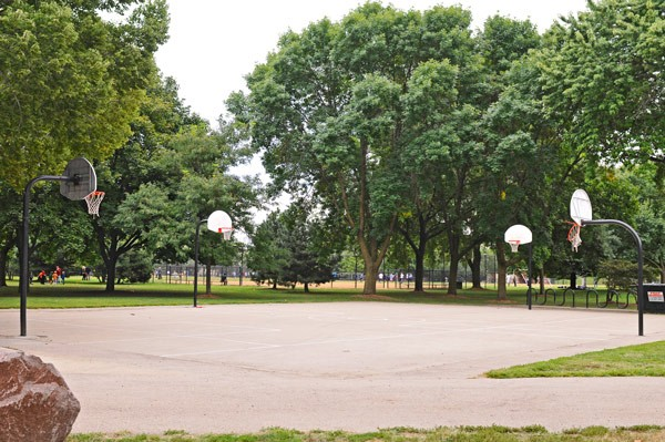 Oz Park, Lincoln Park: While school officials want the hoops removed or locked up during weekdays, community leaders and the Park District have balked. - ANDREA BAUER