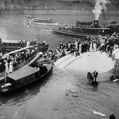 Passengers wait for help after the Eastland capsized in the Chicago River on July 24, 1915. More than 800 others didn't make it out alive.