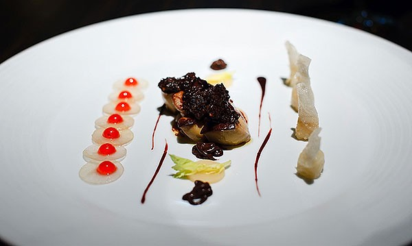 Pear slices topped with a jelly, celery in fried wonton skin, chocolate crisps on top of seared foie gras at L2O
