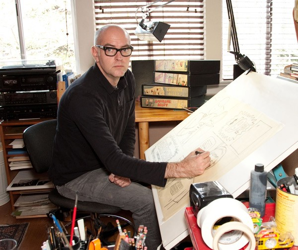 [photograph of Daniel Clowes working]