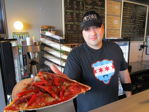 Pie-Eyed Pizzerias owner Ian Muellner with the Monster