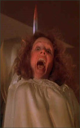 Piper Laurie, as the title characters wacky mom, in Carrie (1976)