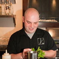 Vie's Mike Page makes the Ecto Shrub Place ten sprigs of mint in the bottom of a shaker. Andrea Bauer