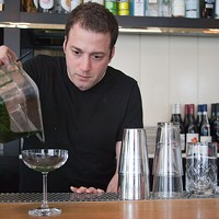 Johnny Costello Jr. of GT Fish & Oyster makes the Forager Pour about an eighth of an inch of stinging nettle juice (stinging nettles blanched and run through a juicer) into the bottom of a coupe glass. Jacob Yeung