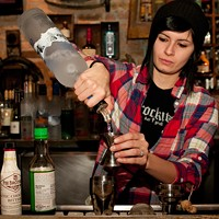 Gina O'Brien makes the Simply Soy Pour two ounces of Grey Goose vodka into a shaker. Andrea Bauer