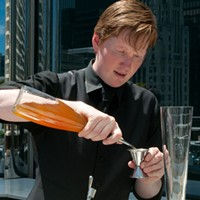 Step-by-step instructions for making Ingi Sigurdsson's sweet potato swizzle Pour two ounces of the sweet-potato-infused rum into a pilsner glass.