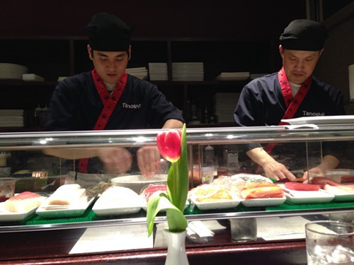 Preparing the sushi at Tanoshii Sushi Mike