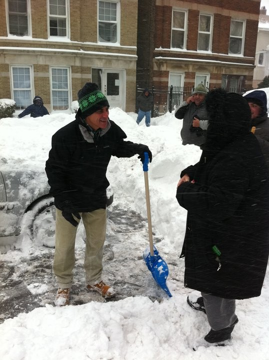 Rahm Emanuel shovels snow in Roscoe Village.