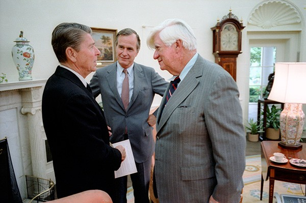 Reagan, backed by Vice President George Bush (center), was willing to moderate his conservative principles to cut deals with Democratic House speaker Tip O'Neill (right).