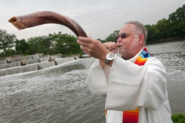 Rev. Rod Reinhardt at a water blessing along the Calumet River - LLOYD DEGRANE