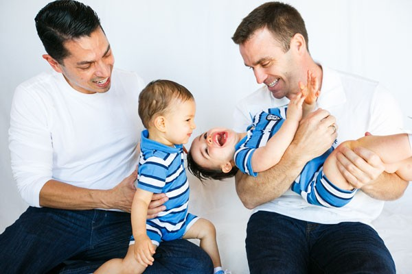 Ricardo Mendoza and Nick Kluding with their children