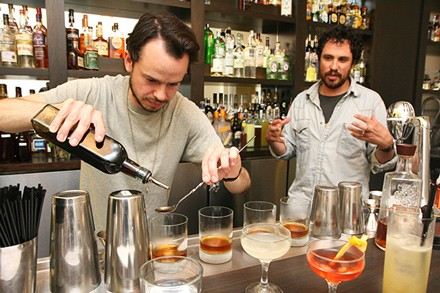 Robert Haynes (left) and Henry Prendergast (right) experiment with recipes in a space used by mixologists to test cocktails.