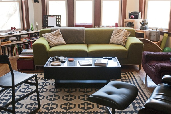 Roth's living room has minimalist furniture and tons of books and cameras on display.