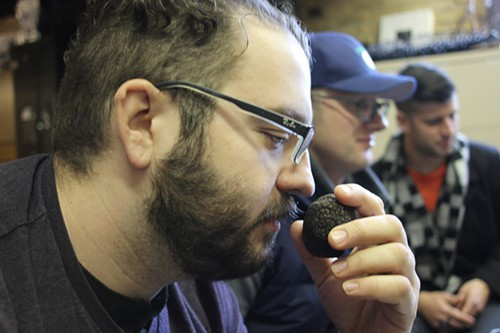 Scott Manley sniffs a black truffle