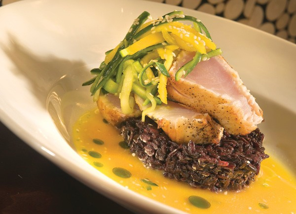 Seared wahoo with purple sticky rice, mango, cucumber, and a lemongrass-orange jus at Eve