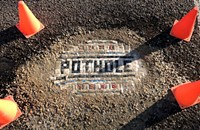 Show us your . . . pothole art