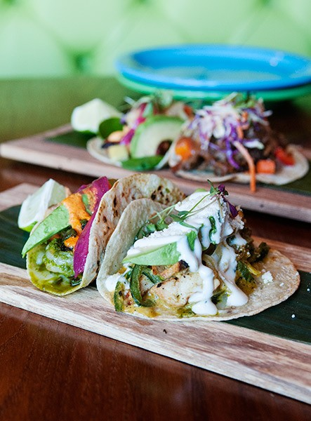 Singly served tortillas are heaped with as many as eight ingredients to create a Kokopelli taco.
