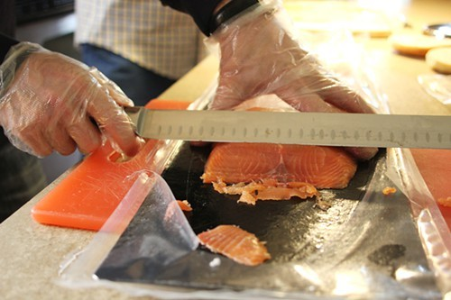 Slicing a D-cut from a salmon fillet