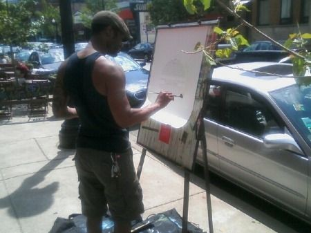 Spare Parts co-owner Donte Mearon at work outside his store