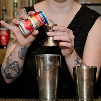 Step-by-step instructions for making a Barrelhouse Flat bartender's Takis cocktail Start with an ounce of tomato juice. Eileen Meslar