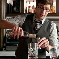 Step-by-step instructions for making a Graham Elliot Bistro bartender's Madras curry cocktail Start with two ounces of Zaya 12-year rum. Andrea Bauer