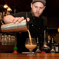 Step-by-step instructions for making a Barrelhouse Flat bartender's sriracha cocktail Strain into a snifter. Andrea Bauer