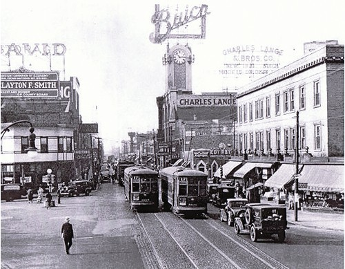 Taken in 1936, this showcases some of the horse-drawn lines that ran up Milwaukee before the Blue Line was built. You can see the Charles Lange 7 Bros. Buick Dealership in the background.