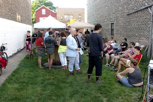 The crowd in the side yard. Theyre pouring beer under those tents. Not pictured: High-level multiple-dog foolishness.