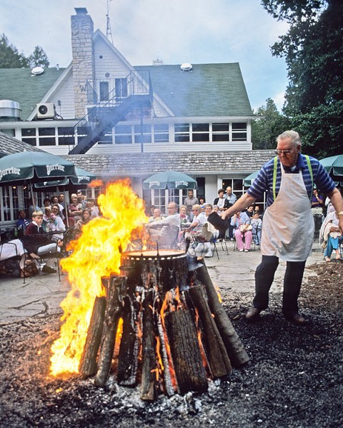 The crowning moment of a fish boil: when the boilmaster pours kerosene on the flames. - WISCONSIN DEPARTMENT OF NATURAL RESOURCES