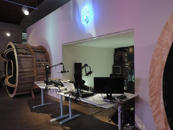 The current WLPN studio at the Co-Prosperity Sphere. Local artist Juan Angel Chavez built the giant speakers.