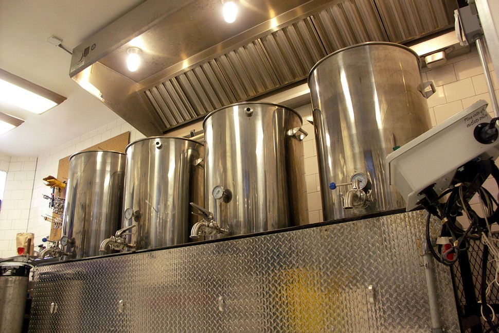 The gas burners under these brew kettles can heat this whole room to nearly 130 degrees.