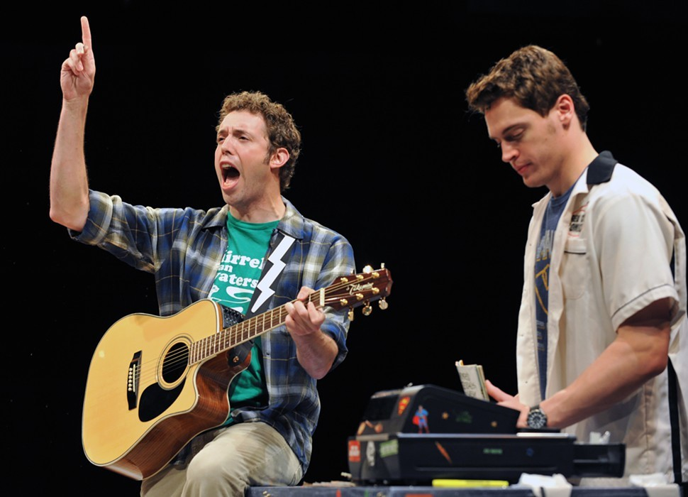 The Hero of Hero: The Musical? The unhappy-looking guy on the right