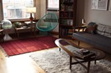 The living room with the Acapulco chair and handwoven rug from Mexico - ANDREA BAUER