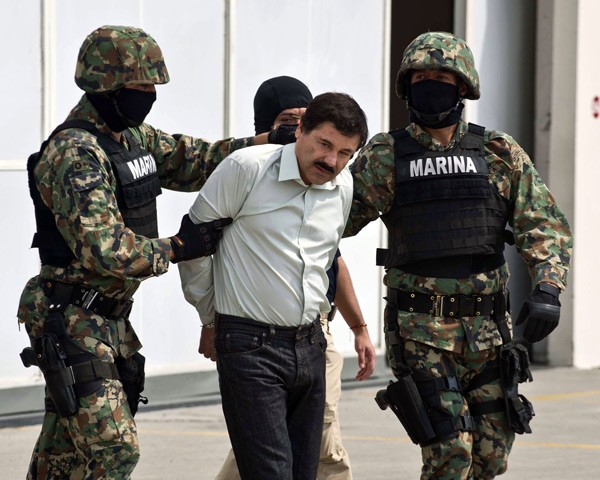 The Mexican navy arresting Sinaloa cartel leader El Chapo Guzman.