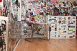 The mini sticker studio is virtually wallpapered in stickers. - ANDREA BAUER