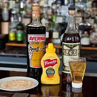 """Spiaggia's Brendan Smith whips up some """"dessert mustard"""" The other ingredients: crushed honey-mustard pretzels (for garnish), the Sicilian liqueur Averna Amaro, A.E. Dor Napoleon cognac, and Miele Thun acacia honey Andrea Bauer"""