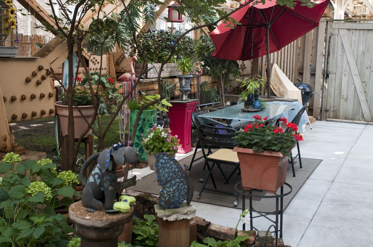 a grassy oasis beneath the red line tracks in boystown space