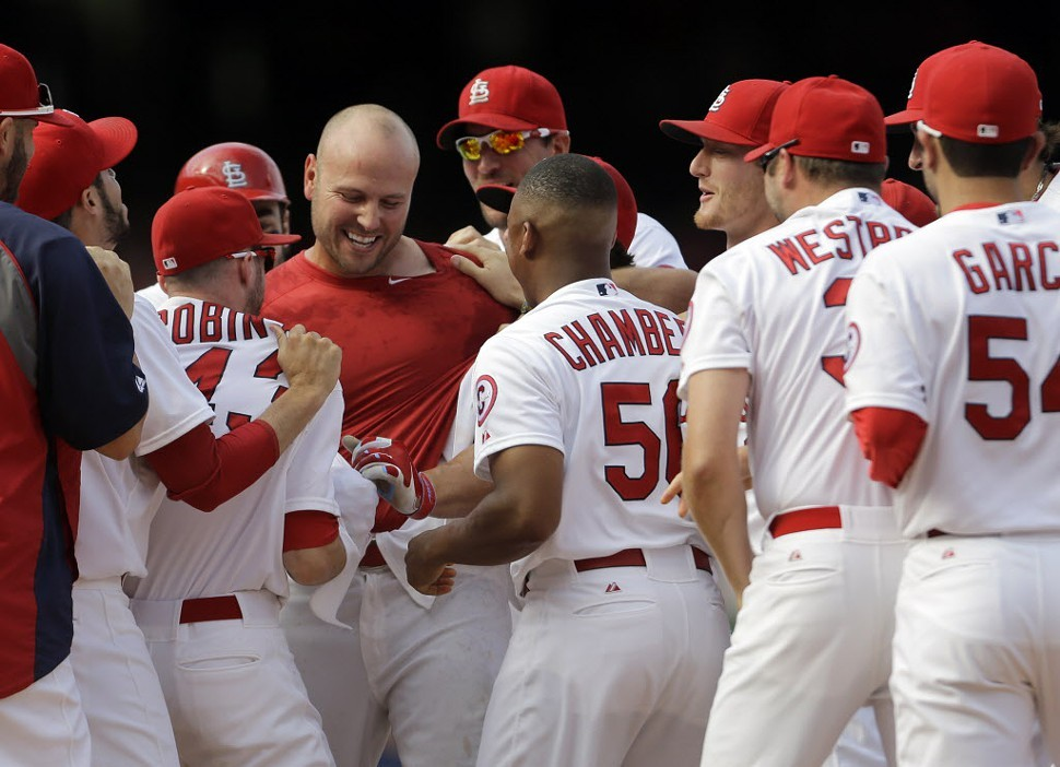 The Saint Louis Cardinals celebrate Matt Hollidays walk-off.