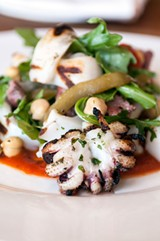 The smoky, tender Spanish calamari is actually made with cuttlefish. - ANDREA BAUER