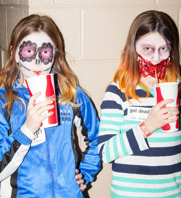 These girls got Cokes and makeovers—one to look like a Tim Burton-esque doll and the other a zombie. - PARKER BRIGHT