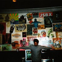 """Canadian hardcore band Single Mothers' photos from their trek through Detroit and Chicago """"This is Drew in the green room of Metro in Chicago. They have an awesome collection of screen-printed posters commemorating past shows that they've lacquered to the walls."""" Leor Galil"""