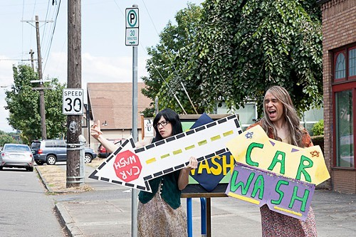 Toni (Carrie Brownstein) and Candace (Fred Armisen) hold a fairly unsexy car wash.