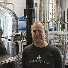 Tremaine Atkinson with a still at CH Distillery.