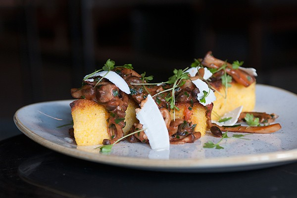 Triangles of baked polenta are textural pleasures—crispy on the outside, creamy in the middle.
