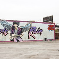 A Prince tribute mural has appeared over Logan Square