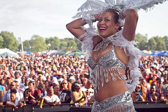 A dancer hypes the crowd at the 2012 picnic. - DAWN COLQUITT-ANDERSON