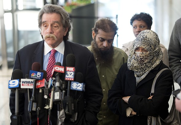 Thomas Durkin, the attorney for Mohammed Hamzah Khan, addresses reporters after an October 2014 bond hearing, as Khan's parents, Shafi and Zarine, look on. - BRIAN KERSEY/GETTY IMAGES