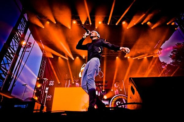 """Chance the Rapper's self-proclaimed """"historic"""" performance included Kirk Franklin and extremely orange lights. - ALISON GREEN"""