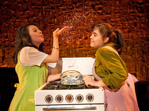 Gissela Gualoto and Stephany Perez in Albany Park Theater Project's 2010 production of Feast at Goodman Theatre. - AMY BRASWELL